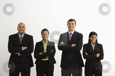 Smiling businesspeople. stock photo, Portrait of businessmen and businesswomen standing smiling with arms crossed. by Iofoto Images
