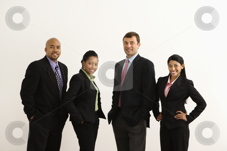 Happy businesspeople. stock photo, Portrait of businessmen and businesswomen standing smiling against white background. by Iofoto Images