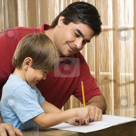 Dad helping son. stock photo, Hispanic father helping son with homework. by Iofoto Images