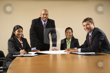 Corporate business. stock photo, Businesspeople having meeting at conference table. by Iofoto Images