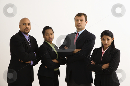 Serious business portrait. stock photo, Portrait of businessmen and businesswomen standing with arms crossed looking serious. by Iofoto Images
