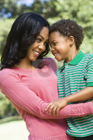 Mother and son smiling. stock photo, Mother and son with arms around ...