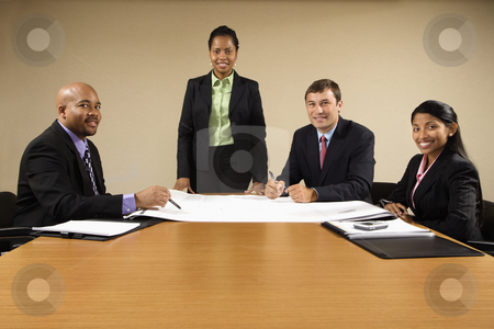 Office meeting. stock photo, Businesspeople having meeting at conference table. by Iofoto Images
