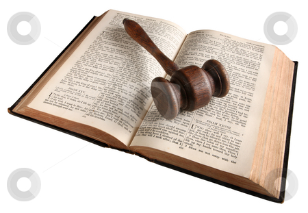 A wooden judge's gavel on an 1882 bible. stock photo, A wooden judge's gavel on an 1882 bible. by Stephen Rees