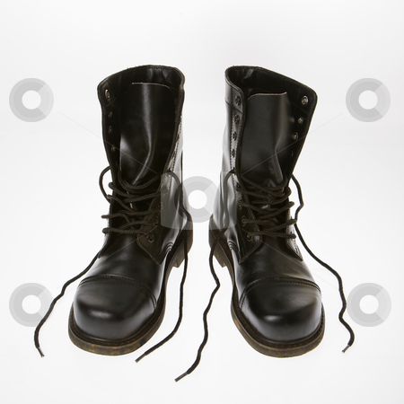 Combat boots. stock photo, Black leather boots with laces untied. by Iofoto Images