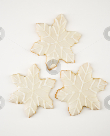 Snowflake cookies. stock photo, Three snowflake sugar cookies with decorative icing. by Iofoto Images