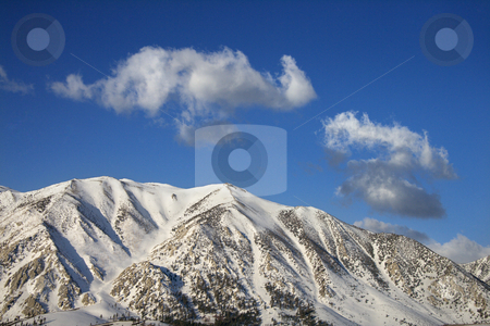 Mountain peaks. stock photo, Aerial landscape of snow covered mountain peaks in California, USA. by Iofoto Images