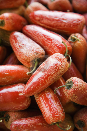 Red Serrano peppers. stock photo, Pile of red Serrano peppers at produce market. by Iofoto Images