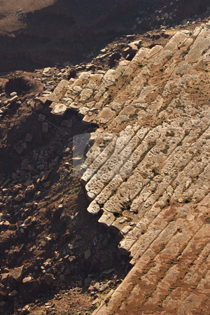 Rocky cliff aerial. stock photo, Aerial of deteriorating rock cliff in high desert of Utah, USA. by Iofoto Images