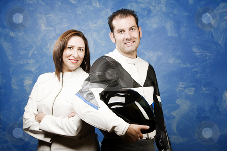 Couple in leather motorcycle clothing stock photo, Attractive couple wearing high-end motorcycle gear by Scott Griessel