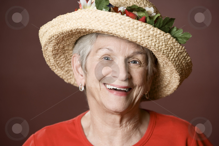 Senior woman in a straw hat stock photo, Senior woman in a red shirt and straw hat by Scott Griessel