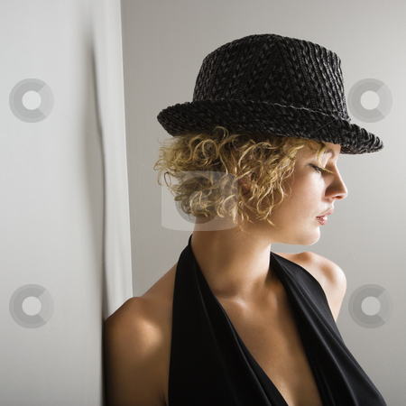 Woman wearing fedora. stock photo, Profile of Caucasian young adult woman wearing fedora hat with eyes closed. by Iofoto Images