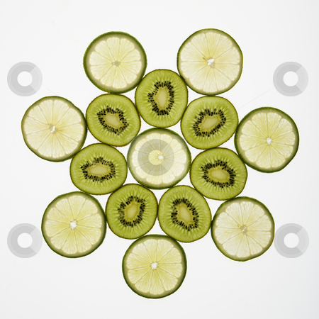 Fruit pattern. stock photo, Kiwi and lime fruit slices arranged on white background. by Iofoto Images