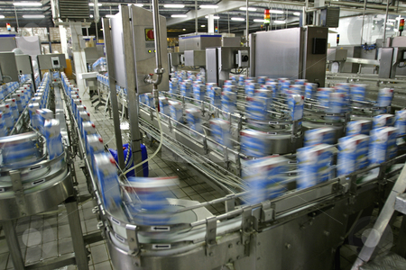 Production line in modern dairy factory stock photo, Automated production line in modern dairy factory by Mark Yuill