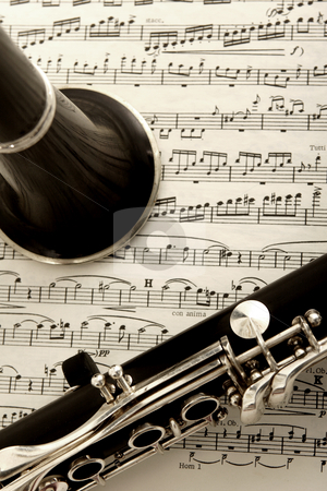Clarinet and sheet music stock photo, Close up photograph of clarinet and sheet music by Mark Yuill