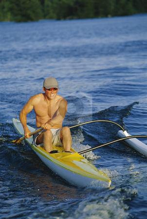 Man canoeing at sunset
