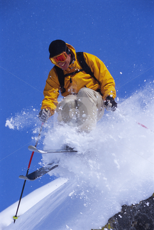 Young man skiing stock photo,  by Monkey Business Images