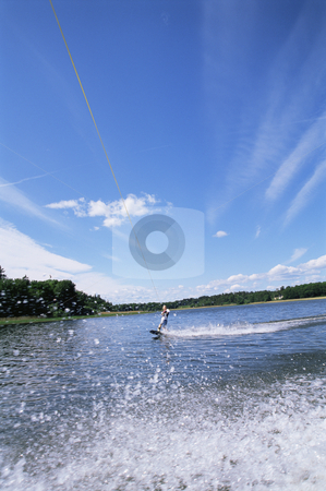 A young woman water skiing stock photo,  by Monkey Business Images