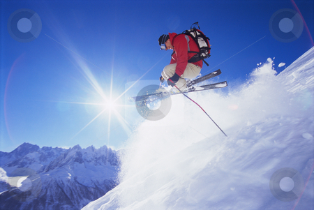 Young man skiing stock photo, Young man skiing down mountain slope by Monkey Business Images