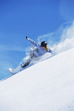 Young woman snowboarding stock photo, Young woman snowboarding on slopes by Monkey Business Images
