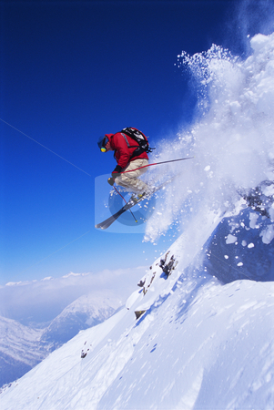 Skier jumping stock photo, Snow Skier jumping on slopes by Monkey Business Images
