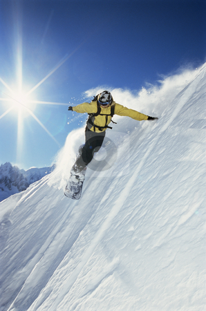 Snowboarder stock photo, Snowboarding going down a steep hill by Monkey Business Images