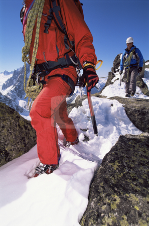 Young men mountain climbing stock photo, Young men mountain climbing on snowy peak by Monkey Business Images