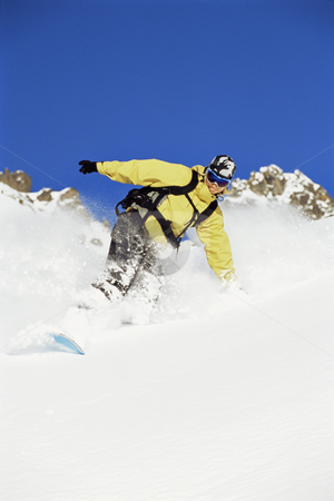 Snowboarder stock photo, Young woman snowboarding by Monkey Business Images