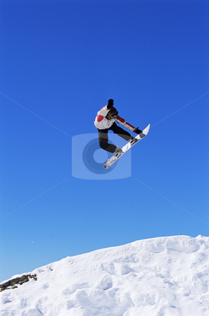 Snowboarding stock photo, Young man snowboarding by Monkey Business Images