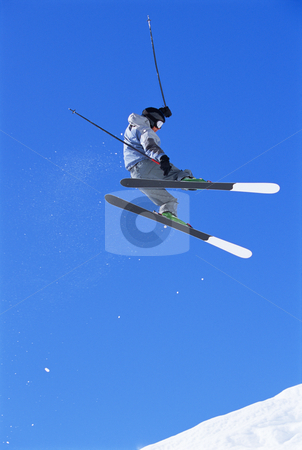 Skier jumping stock photo, Snow Skier jumping in air by Monkey Business Images