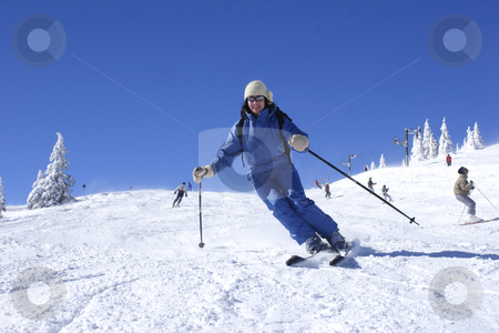 Woman skiing stock photo, Woman skiing by Mark Yuill