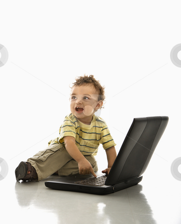 Baby using laptop. stock photo, Happy African American toddler boy on laptop computer looking to side. by Iofoto Images