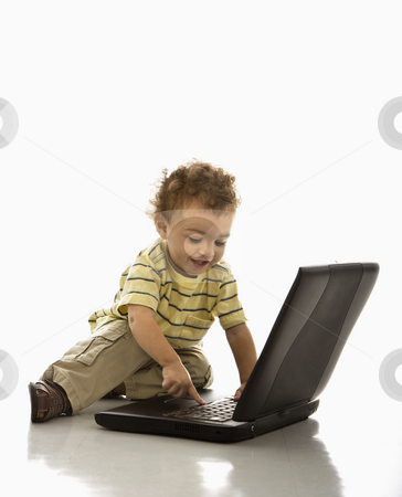 Baby on computer. stock photo, Happy African American toddler boy on laptop computer. by Iofoto Images