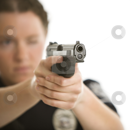Policewoman aiming gun. stock photo, Close up of mid adult female Caucasian law enforcement officer aiming gun at viewer with one eye closed. by Iofoto Images