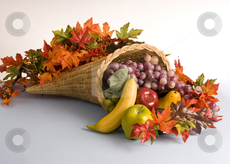 Cornucopia, the horn of plenty stock photo, A horn shaped basket filled with colorful decorations by RCarner Photography
