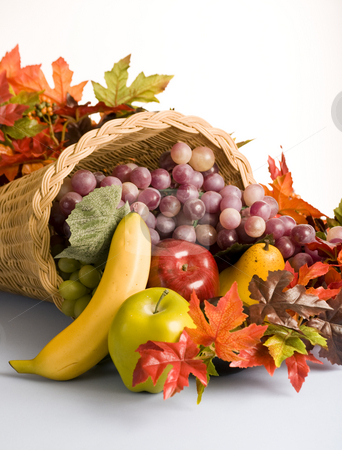 Basket filled with fruit decorations stock photo, The open mouth of a cornucopia the horn of plenty by RCarner Photography