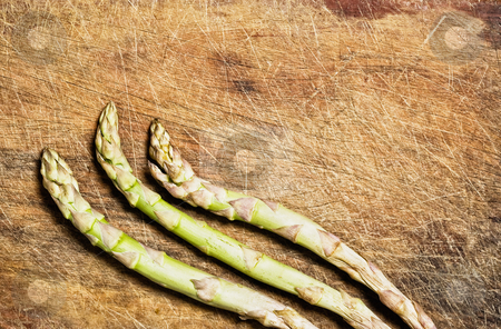 Bunch of asparagus stock photo, Bunch of asparagus on old wooden table. by Pablo Caridad