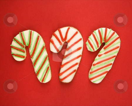 Candy cane cookies. stock photo, Three candy cane sugar cookies with decorative icing. by Iofoto Images