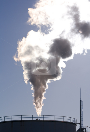 Industrial plant stock photo, Industrial plant exhausting smokes into the atmosphere blocking the sun. by Paulo Resende