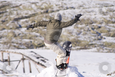 Snowboard Jump stock photo, Men jumping on a snowboard by Paulo Resende