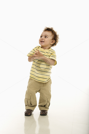 Happy toddler boy. stock photo, African American toddler boy standing with hands together and happy expression. by Iofoto Images