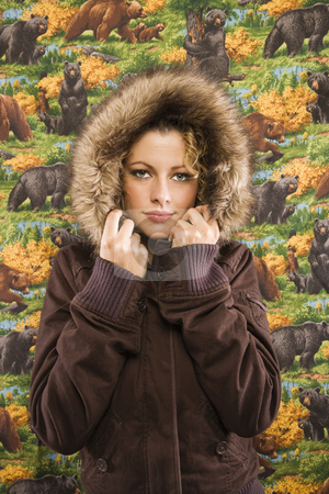 Woman in winter coat. stock photo, Caucasian young adult woman wearing coat with fur hood looking at viewer. by Iofoto Images
