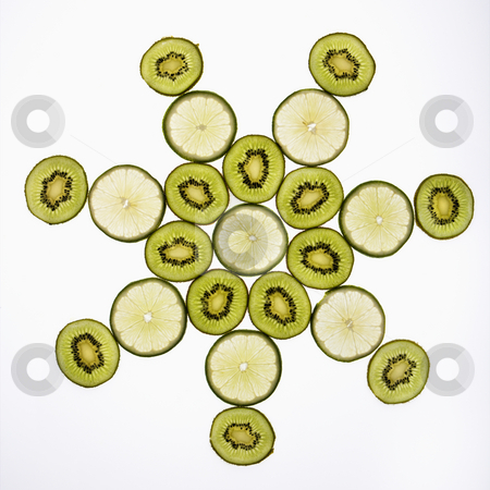Fruit design. stock photo, Kiwi and lime fruit slices arranged on white background. by Iofoto Images