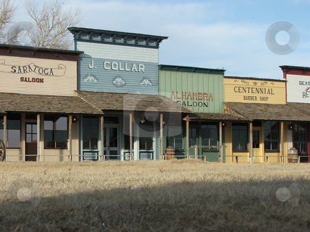 Dodge City Museum Storefronts stock photo, Dodge City, Kansas gained fame during cattle drives of the late 19th and early 20th century. The famous western town now offers tourists a glimpse of historical Dodge City through the Boot Hill Museum, a western history village, on the former site of the actual boot hill in downtown Dodge City.  This is Dodge City's number one tourist attraction with re-enactments of gunfights, exhibits, historical memorabilia, and a reconstruction of 1876 Dodge City. by Dennis Thomsen