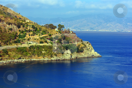 View from Scylla stock photo, View on a colorful peninsula and CCharybdis town in Sicily from Scylla town in Calabria through Messina strait in Italy by Natalia Macheda