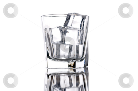Empty glass with ice cubes stock photo, Empty glass with ice cubes by Vince Clements