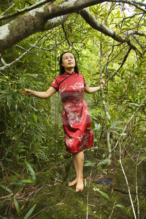 Portrait of asian woman. stock photo, Portrait of Asian American woman in ethnic attire standing on rock in bamboo in Maui, Hawaii. by Iofoto Images