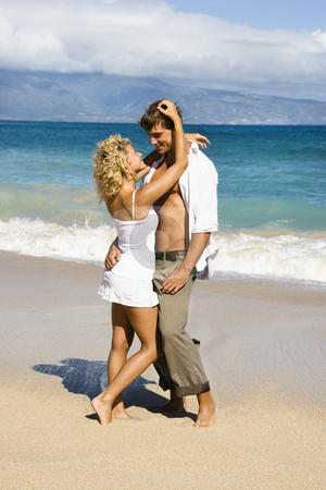 Sensual couple. stock photo, Attractive couple in sensual embrace on Maui, Hawaii beach. by Iofoto Images