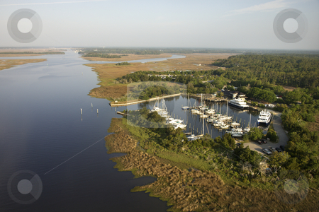 Marina in wetlands. stock photo, Aerial view of marina in wetlands of Bald Head Island, North Carolina. by Iofoto Images