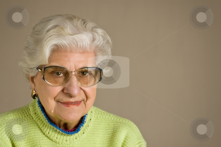 Senior lady portrait,  glasses, with copy space. stock photo, Senior lady portrait, smiling, with glasses, with copy space. by Pablo Caridad